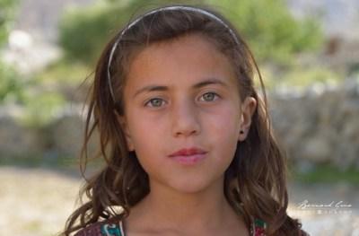 Wakhi: Passu, Sabeen, one of Mr. Berham Baig's daughter, with stunning green eyes. She was already a little actor for a Pakistani TV movie. © Bernard Grua