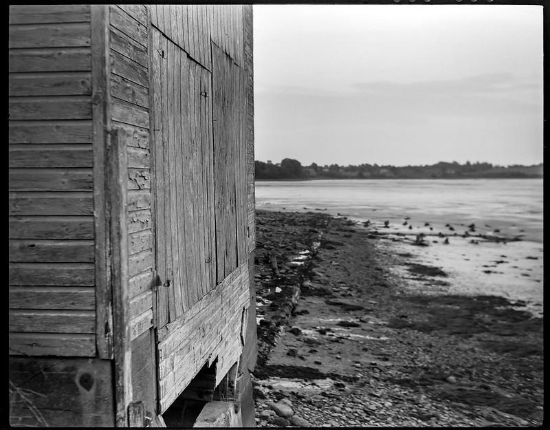 old harborside building, dock remnants, low tide, Thomaston, Maine, Koni Omega Rapid 100, Super Omegon 90mm f/3.5, Kodak TMAX 400, Kodak TMAX developer, late August 2018