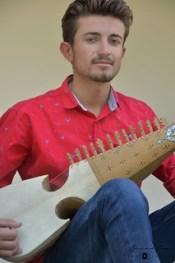 Tahir Hussain, from Chapursan, playing rubab © Bernard Grua