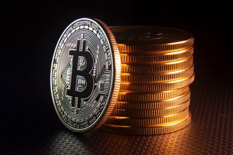 Bitcoin leaning against stack of Bitcoins | Bitcoin on edge … | Flickr