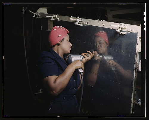"""Operating a hand drill at Vultee-Nashville, woman is working on a """"Vengeance"""" dive bomber, Tennessee  (LOC)"""