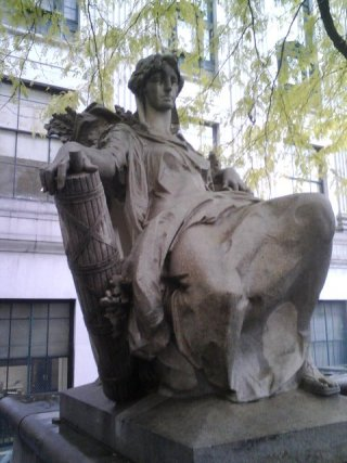 Seated figure outside New York State Supreme Court 2