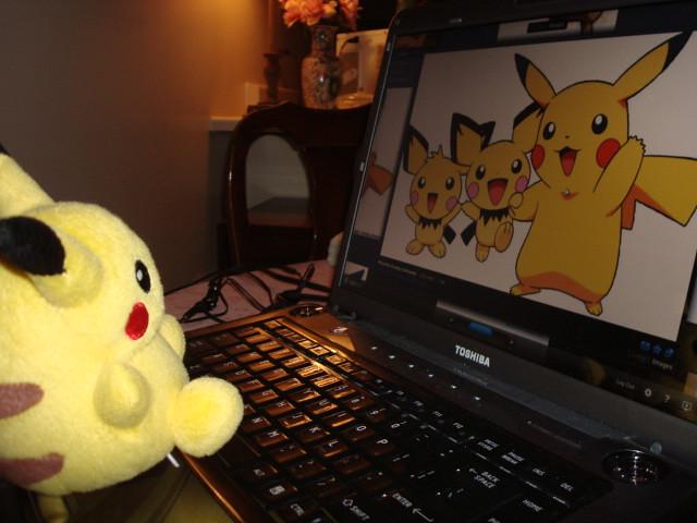 Pikachu Having Fun W Laptop Pikachu Is Viewing Photos
