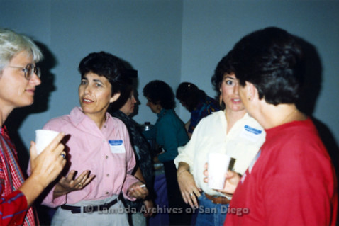 P341.011m.r.t Women's Caucus meeting: Four women socializing at meeting