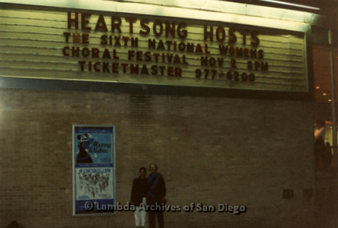 """""""The Magic Music Makes"""" San Diego Women's Chorus (SDWC) first choral festival with Sister Singers 1991: Two Chorus members standing in front of a marquee, Heartsong Hosts the Sixth National Womens Choral Festival Nov 3 8pm"""