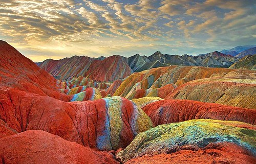 China's rainbow mountains located in the Zhangye Danxia Landform Geological Park in Gansu Province. The technicolor stripes on the rocks show layers of sandstone and mineral deposits that formed on top of one another over the course of 24 million years.