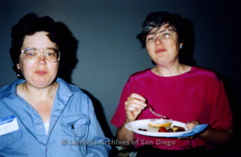 P341.010m.r.t Women's Caucus meeting: Cathy and Christine Kehoe (in pink) eating food