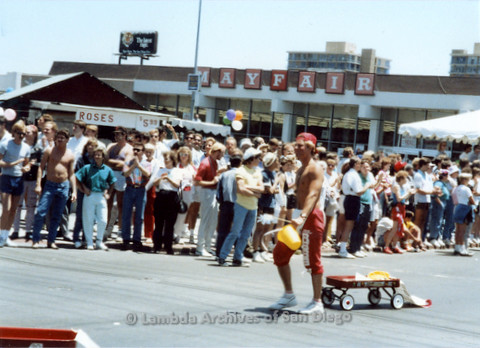 P018.030m.r.t San Diego Pride Parade 1988: Man pulling a red wagon