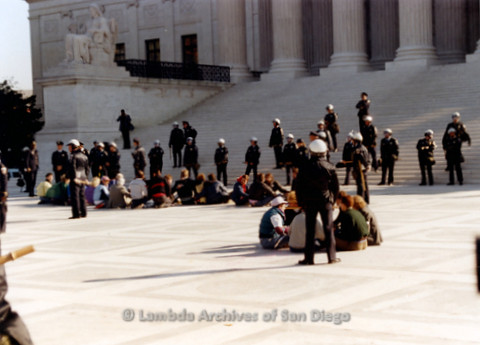 P019.250m.r.t Second March on Washington 1987: People sitting besides the steps of the Capitol Building with police in background