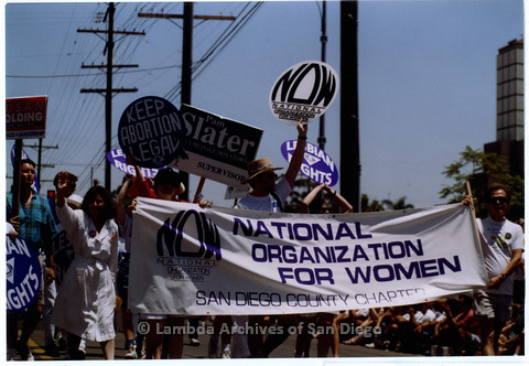 P201.017m.r.t San Diego Pride Parade 1992: Marchers carrying signs for the National Organization for Women (NOW)