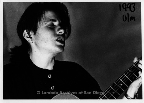 October 1993 - San Diego Native, Zanne in Germany: Lesbian Performer, Zanne playing guitar.