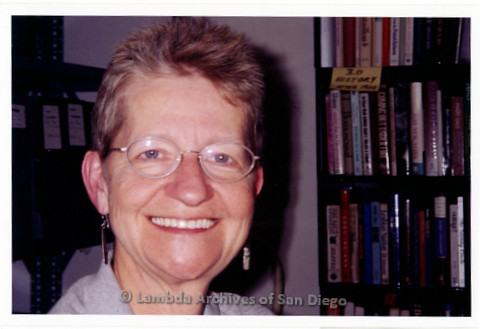 P199.038m.r.t Close up of Sharon Parker in front of bookshelf in Lambda Archives