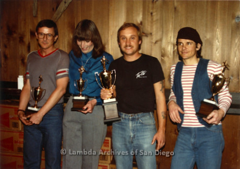 West Coast Pool Challenge at Bee Jay's Country Western Dance Club in San Diego. Paul Bossiere (second right) and other players hold their trophies.
