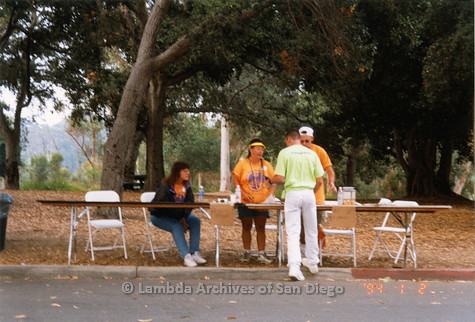 P018.151m.r.t San Diego Pride Festival 1998: Volunteers at registration tables