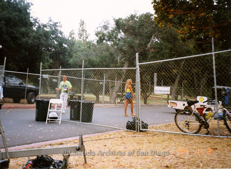 "P018.149m.r.t San Diego Pride Festival1998: ""Gary"" and volunteer in fenced in area"
