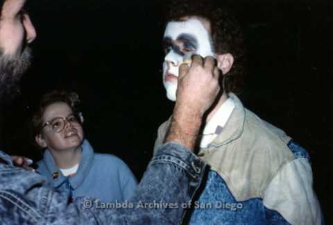 """P019.357m.r.t Los Angeles """"Die In"""" 1988: Man applying make up on another man"""