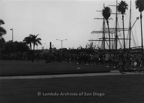 P116.043m.r.t San Diego Walks For Life 1986: Walkers walking along embarcadero with Star of India in background