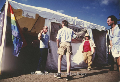 Lesbian and Gay Archives of San Diego Pride Festival tent: Jess Jessop on left, c.1989