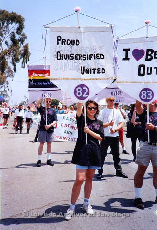 P018.115m.r.t San Diego Pride Parade 1994: Laura holding Lesbian and Gay Archives banner