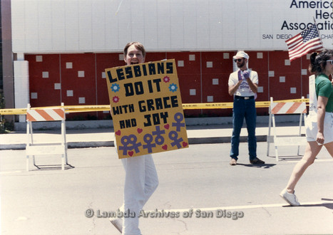San Diego LGBTQ Pride Parade, July 1988: Diane Germain holding a sign 'Lesbians Do It With Grace and Joy'