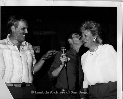 P116.111m.r.t San Diego Walks for Life 1987: Susan Jester as Miss Gay San Diego at Bee Jays being kissed by Jason