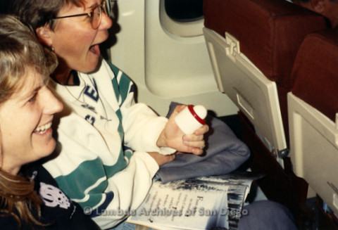 """""""The Magic Music Makes"""" San Diego Women's Chorus (SDWC) first choral festival with Sister Singers 1991: Pianist Deborah Morton and an other Chorus Member on the plane heading back to San Diego."""
