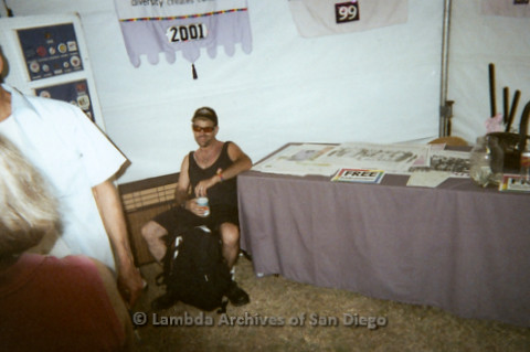 P096.002m.r.t LASD Pride Display: Man sitting at a table with posters