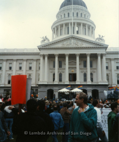 P019.147m.r.t March on Sacramento 1988 / Pre Parade gathering: Crowd of people gathered in front of City Hall
