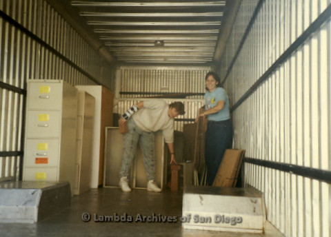 P169.038m.r.t Paradigm Women's Bookstore - Moving in: Two women inside moving truck