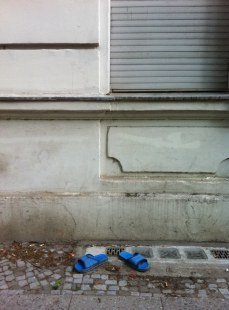 The invisible man wears bath shoes in Berlin.