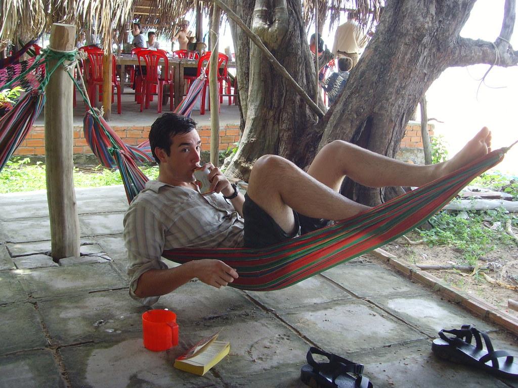 Fat man in a little hammock.