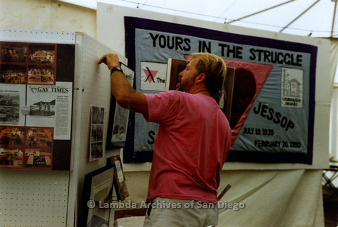 P018.048m.r.t San Diego Pride Festival 1990: Setting up the Lambda Archives display tent, Jess Jessop's AIDS quilt square in the background