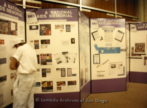 P019.192m.r.t AIDS Quilt at San Diego Golden Hall 1988: Visitor looking at National AIDS Memorial display