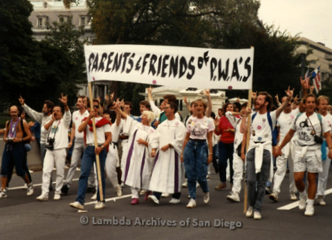 "P019.284m.r.t Second March on Washington 1987: People marching on street, banner reads: ""PARENTS & FRIENDS of P.W.A.'S"""