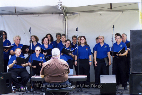 San Diego LGBT Pride Festival, July 2006: San Diego Women's Chorus performing on the LGBT Festival Main Stage with Conductor Chris (sitting at piano, center) Sheila Clark (2nd left, front), Dawn McMorrow (center, center), Karen Kaufman (back row, center)