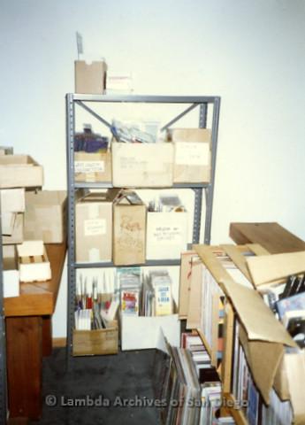 P168.011m.r.t Paradigm Women's Bookstore Kettner Location: Shelf against wall in backroom