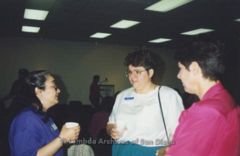 P341.015m.r.t Women's Caucus meeting: Three women conversing at meeting