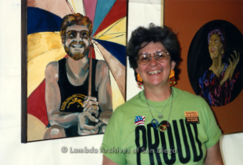 San Diego LGBT Pride Festival, July 1999: Lesbian Artist and Activist Gwen Snyder posing in front of her paintings in the 'Art Of Pride' Tent.