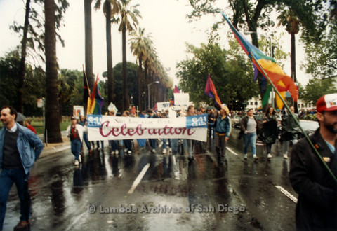 """P019.120m.r.t March on Sacramento 1988 / Parade: People marching with a banner that reads """"641 CLUB San Jose Gay Pride Celebration"""""""