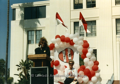 P012.011m.r.t San Diego Walks for Life 1986: Eileen Brennan speaking at podium, with Susan Jester in the background