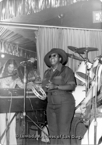 Al Bess (center) performing at a local San Diego Gay Club: With band members.