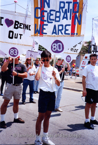 P018.124m.r.t San Diego Pride Parade 1994: Robert Nguyen holding Lesbian and Gay Archives banner