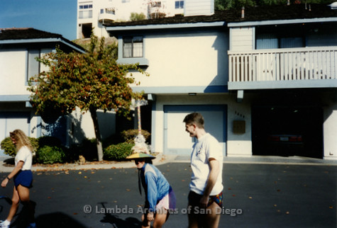 P263.033m.r.t Front Runners and Walkers of San Diego: Candid shot of three members outside of the apartment