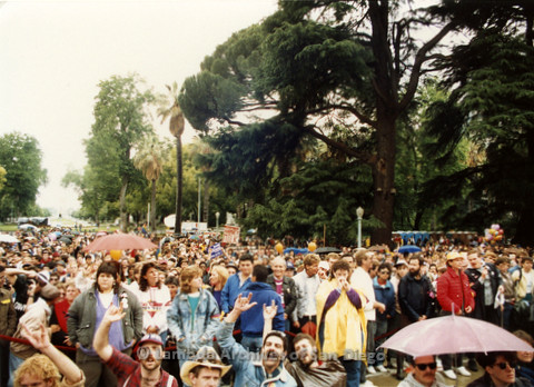 P019.172m.r.t March on Sacramento 1988 / Pre Parade gathering: Large crowd standing behind rope barrier