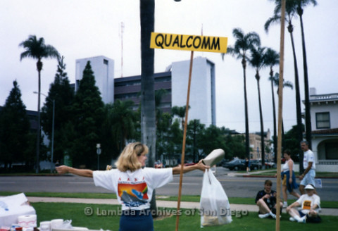 P197.039m.r.t AIDS Walk San Diego 1997: Qualcomm team member displaying the back of her shirt
