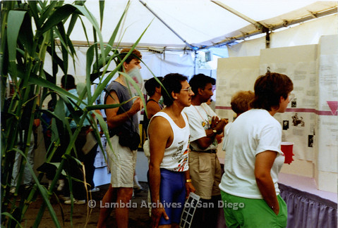 P018.039m.r.t San Diego Pride Festival 1989: Visitors at Lambda Archives display