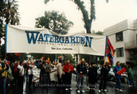 """P019.121m.r.t March on Sacramento 1988 / Parade: People Marching with a banner that reads """"WATERGARDEN RECREATIONAL CENTER San Jose, California"""""""
