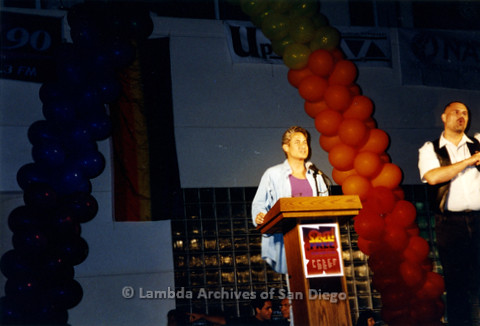 San Diego LGBTQ Pride Rally, July 1997: Greg Louganis speaking at podium on Rally stage