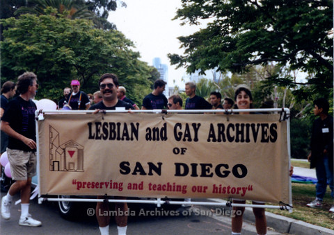 P018.051m.r.t San Diego Pride Parade 1990: Lesbian and Gay Archives banner held by James Burnette and Lori Kaye