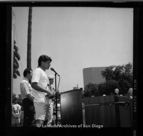 P116.114.02m.r.t San Diego Walks for Life 1987: Side view of Gordon Thomson speaking at podium